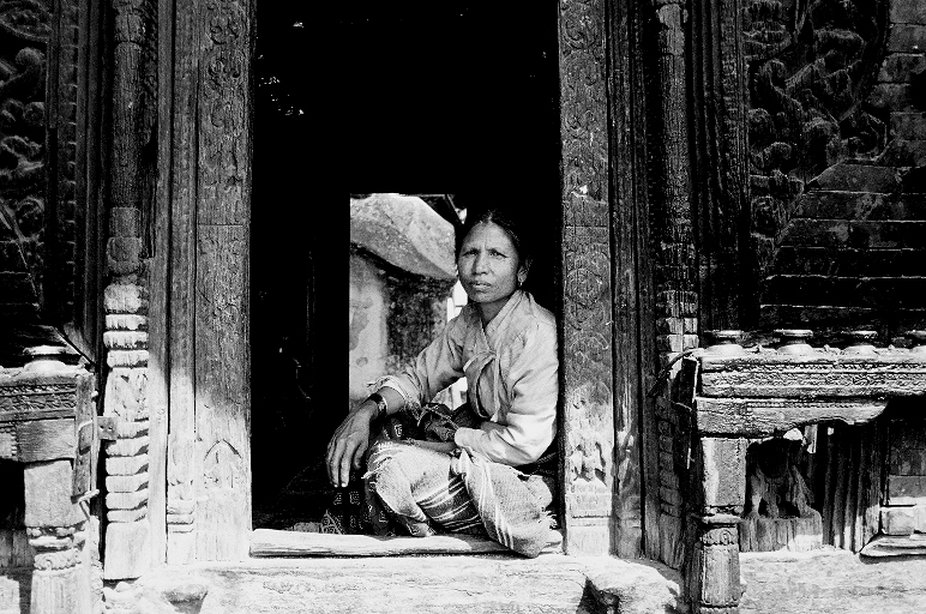 woman sitting outside a temple