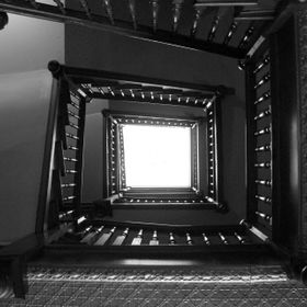 This is a shot straight up the stairwell at the New Orleans Hotel and Spa in Eureka Springs, AR.  There's a skylight at the very top.