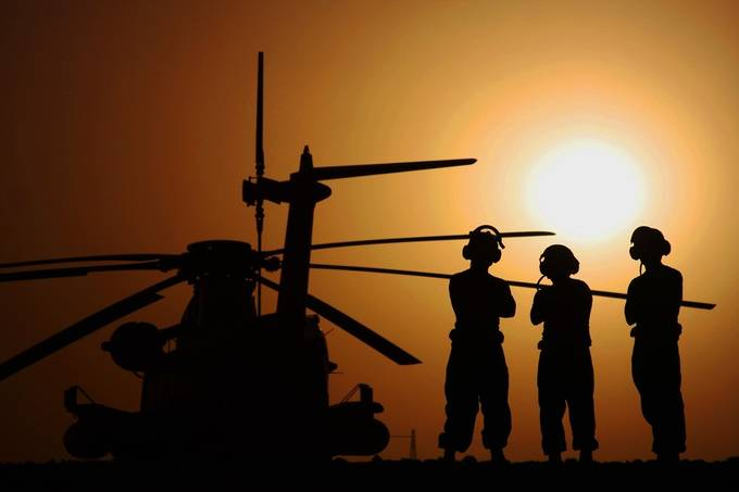 Marines on the flight line in Afghanistan watching the sunset