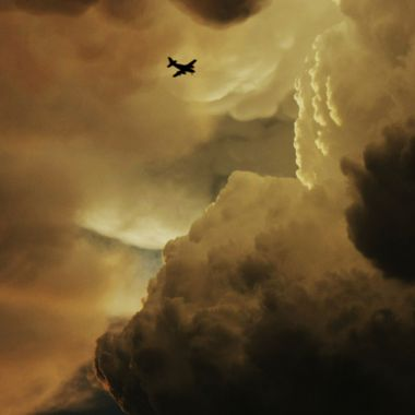 A shot of a plane flying into an on coming storm near my house.