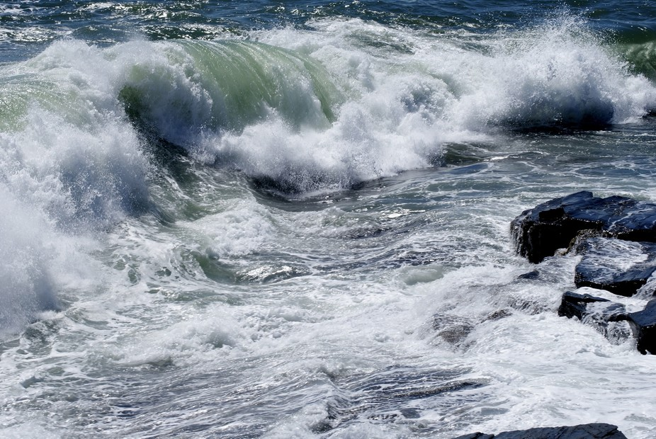 Waves rolling powerfully after a storm in the Atlantic hits the Maine coast.  The beauty of natur...