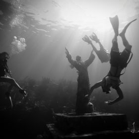 Diving and snorkeling teenagers at Christ of the Abyss in Key Largo, FL