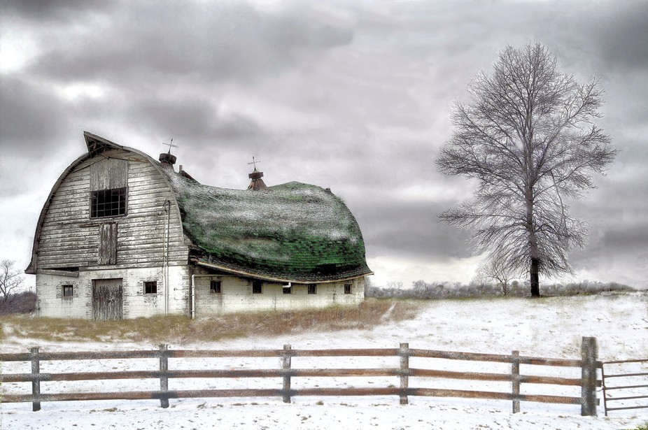 The odd shape and  green color of this barns roof attracted me to it as I passed buy . One week a...