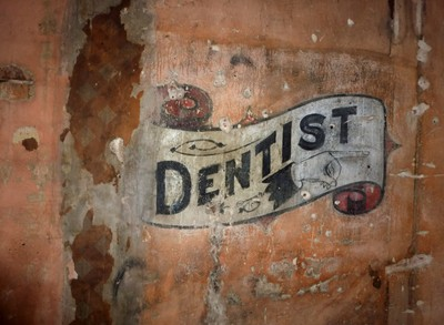 Old Painted Dentist Sign