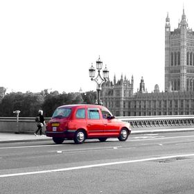 A traditional London Taxi, passing over the bridge at Big Ben