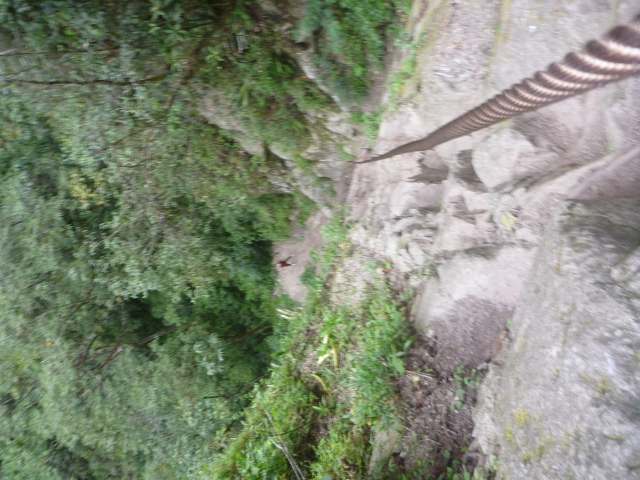 A crazy hike in Peru. The ladders were washed out and all you had to hang on to was a metal wire....