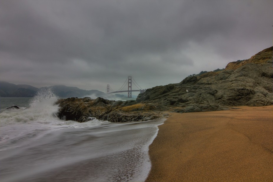 Shot of Baker Beach looking at Golden Gate Bridge and Marin County off in the distance
