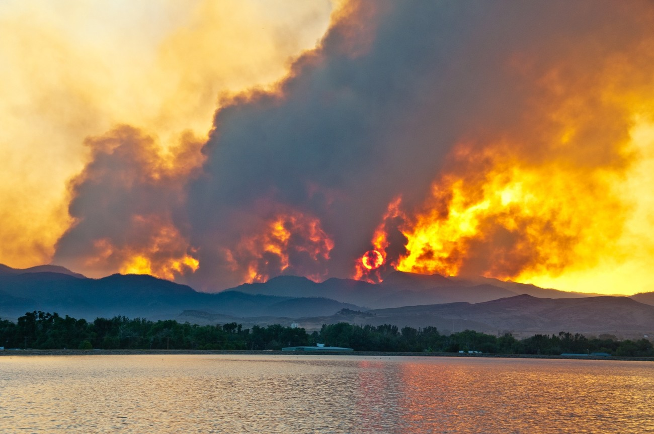Sun setting behind the smoke from the High Park Fire as seen from Terry Lake - Fort Collins Colorado.  Between the hours of 8:00pm and 8:30pm