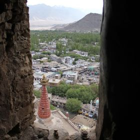 View of a city in north India through a A broken wall of a palace .