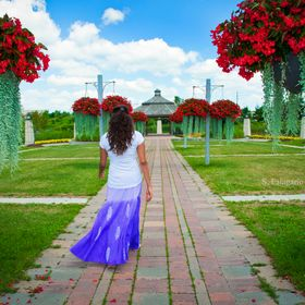 Taken in my hometown of Richmond Hill, ON of my friend Hana, walking down to the gazebo as I followed her from behind. This image is one of my fa...