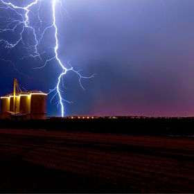 Arizona Monsoon, lightning over grain silos