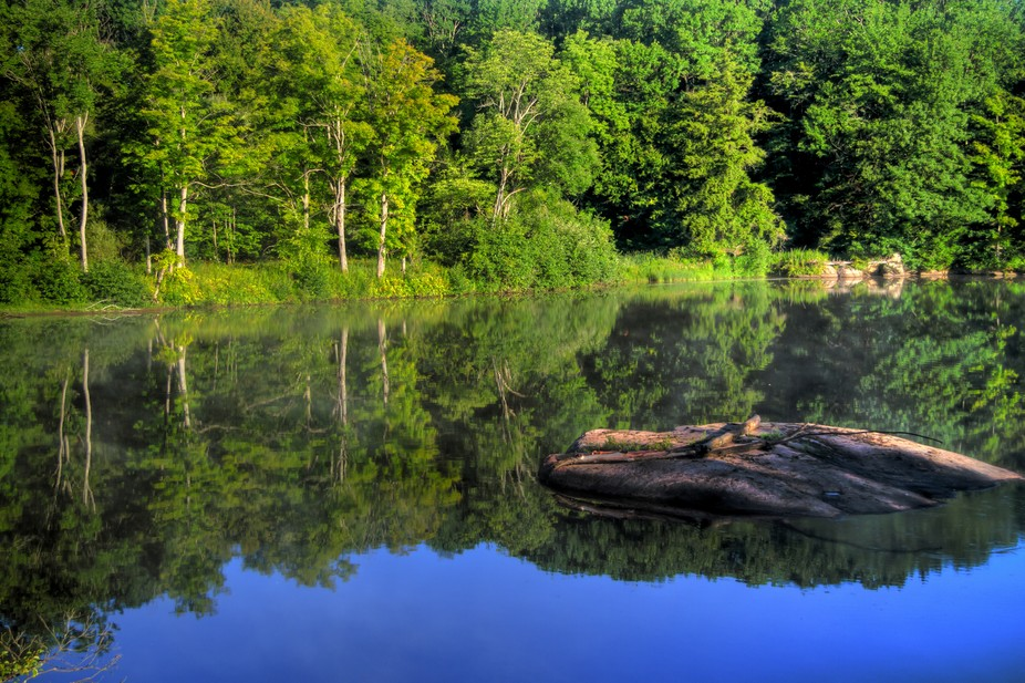 Morning calmness and reflections on the Moose River in New York States Adirondack Mountains.