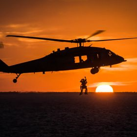 While serving in the U.S. Navy as a Search and Rescue (SAR) Swimmer I was on a flight of the coast of the Bahamas at sunset for a training flight...