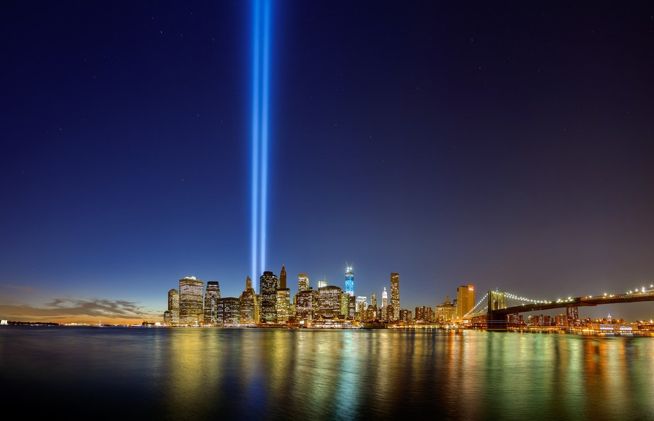 The Twin Tower memorial lights shinning brightly at dusk on the 11th anniversary of the 9-11 atta...