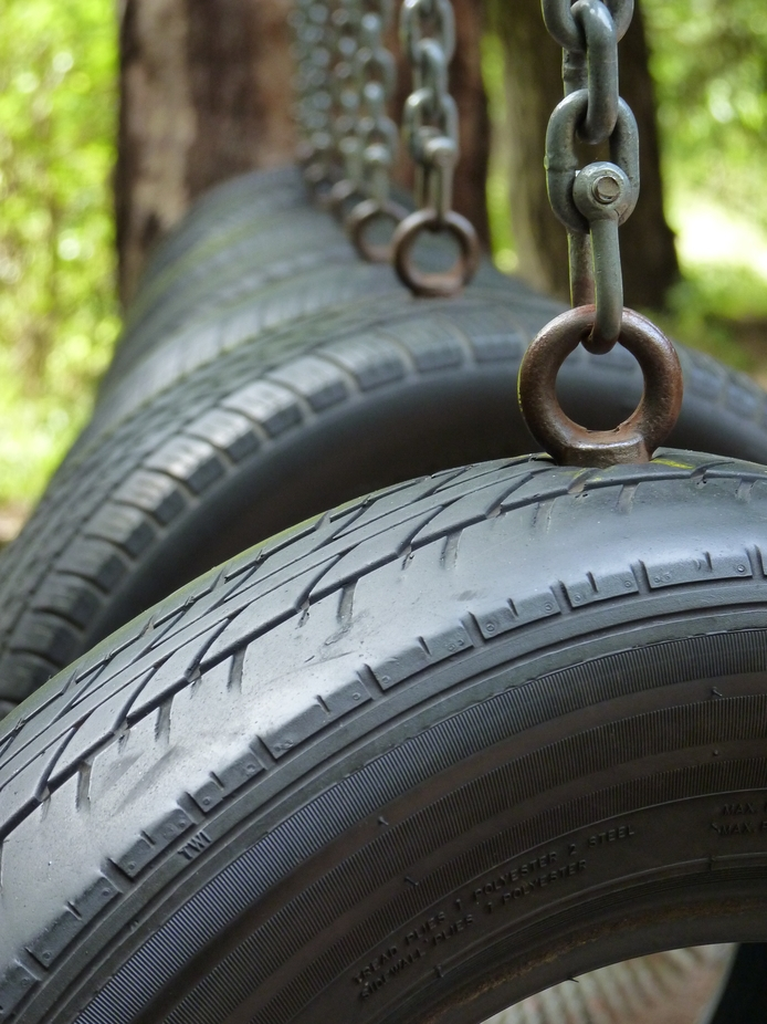Close up of an adventure trail in woodland.  The tyres are part of a bigger activity for people t...