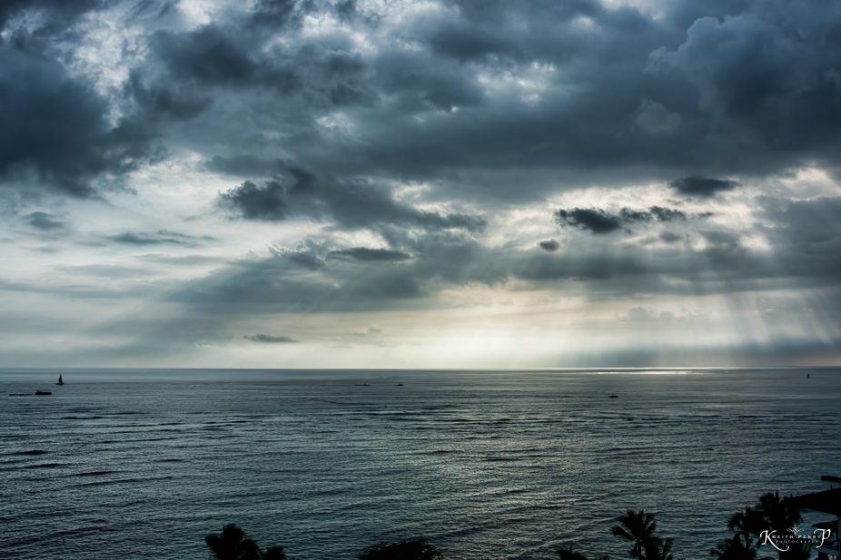 Clouds with the sun breaking through over Waikiki.
