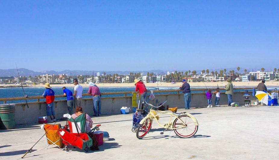 Fishing for dinner on pier in Calif.