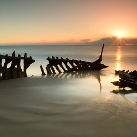 "Sunrise over the wreck of the SS Dicky, ""Dicky"" Beach near Caloundra, Queensland, Australia. One of a series of images taken at this popular ..."