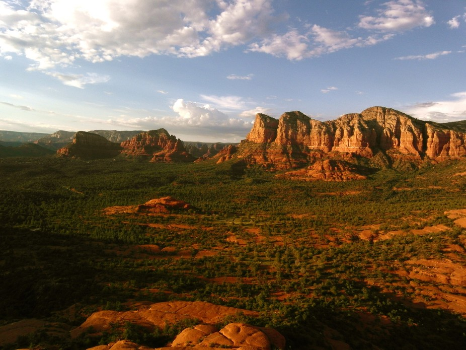 the beautiful Red Rocks light up one last time as the sun sets in Sedona Arizona