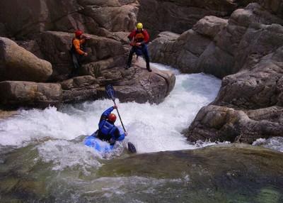 river + rocks + kayakers