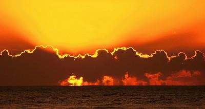 Sunset through cloud horizon