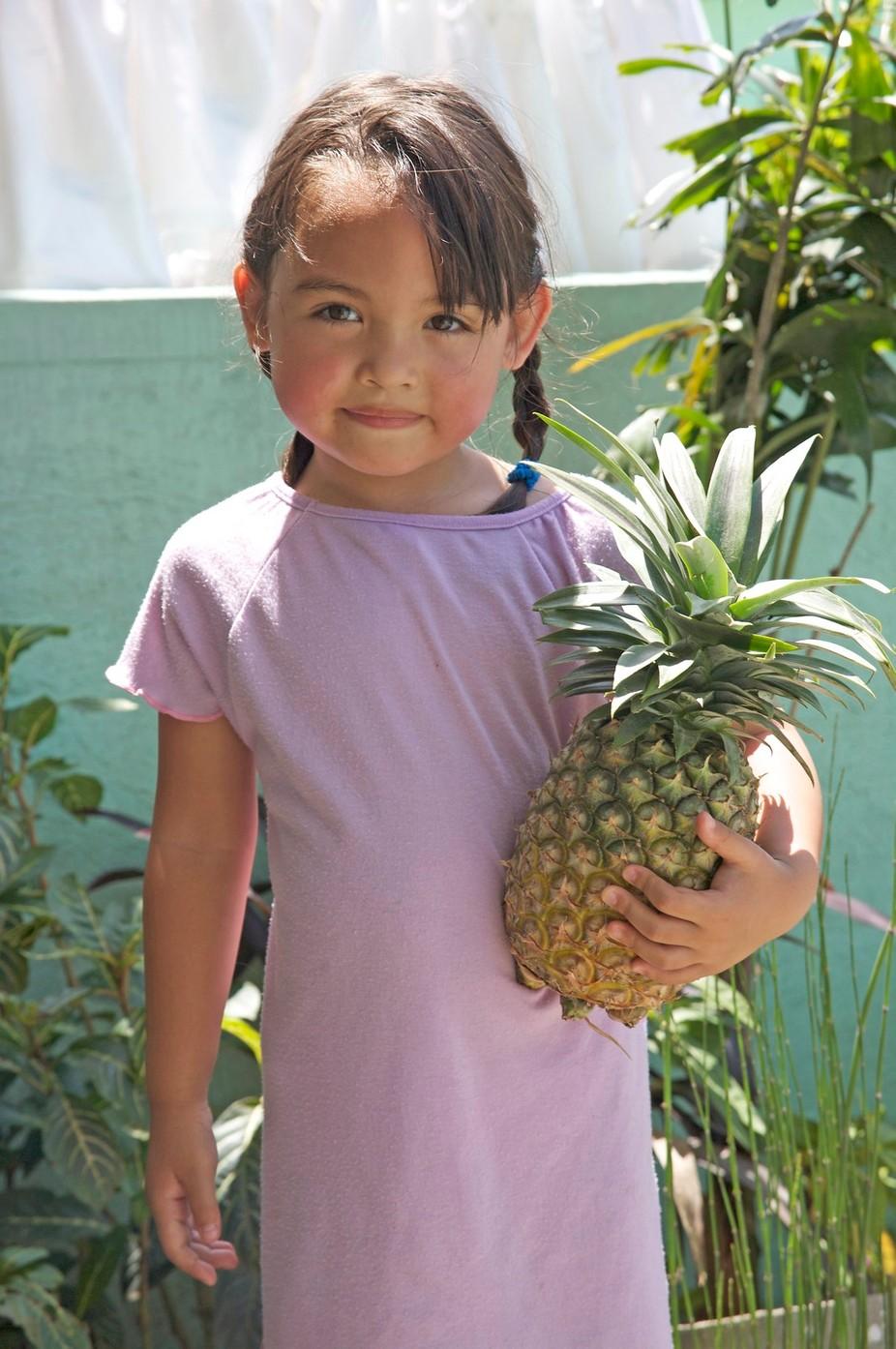 Pretty filipino girl. Holding a pineapple