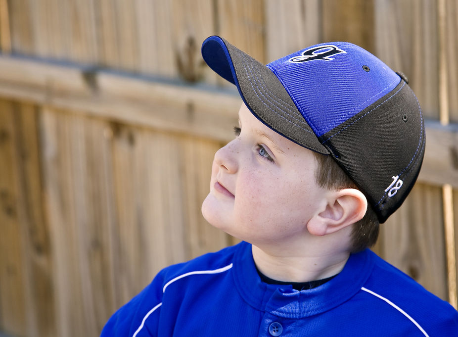Boy dreaming of playing baseball.