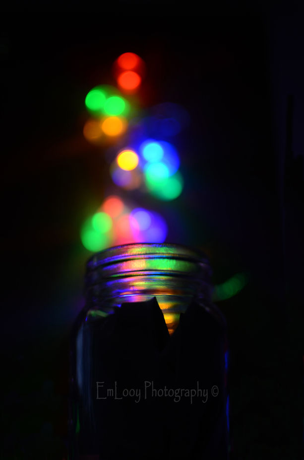 Wall fairylights and a wide jar \'catching\' them.