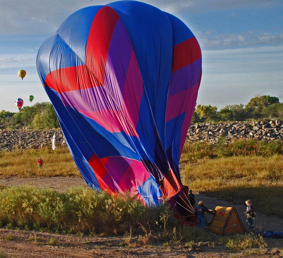 chase crew takin down hot air balloon during the Albuquerque International hot air balloon fiesta