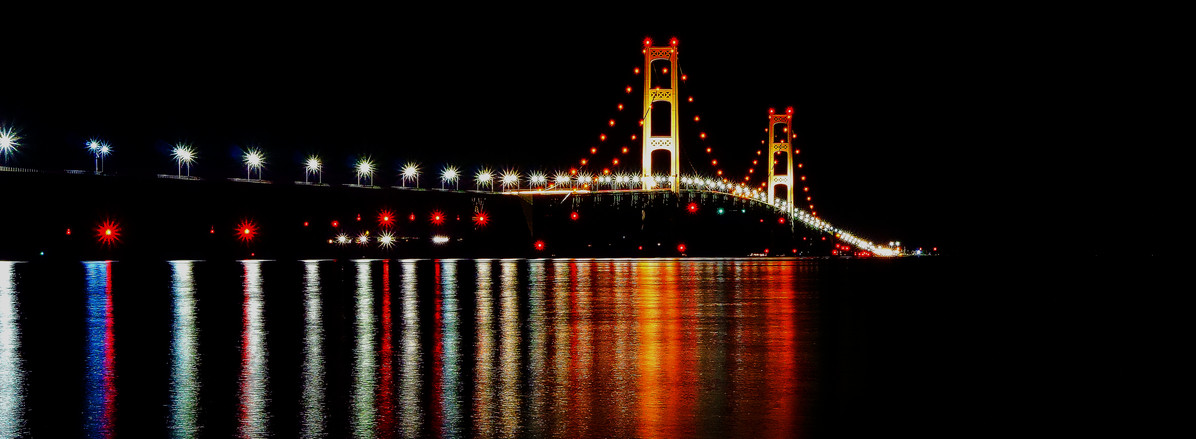 The Mackinac Bridge is a suspension bridge spanning the Straits of Mackinac to connect the non-co...