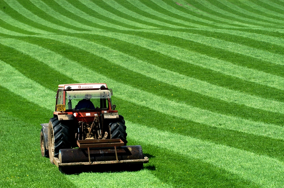 rolling grass with tractor