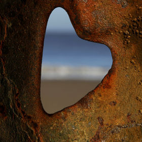 I walked up and down the old sea defences at Happisburgh Beach, Norfolk to find a heart shaped hole in the metal work and this was the closest I ...