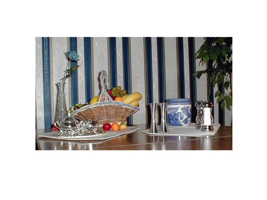 A pretty valentines day table setting in silver and lots of blue