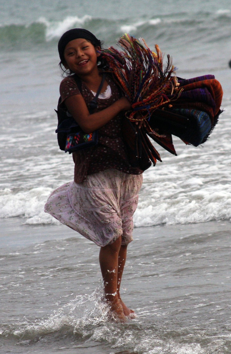 Beautiful child working hard in Bucerias, Mexico.  Still made time for the joy of running in the ...