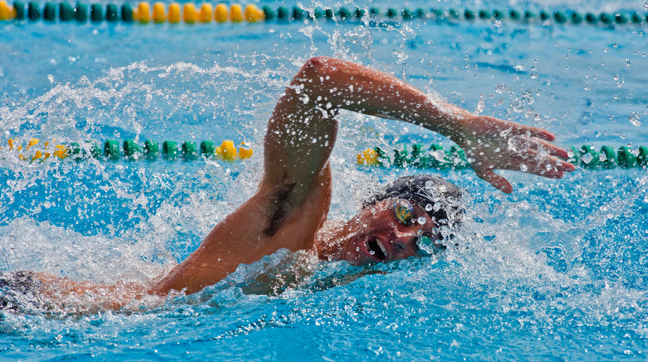 A action shot of a swimmer during a meet.