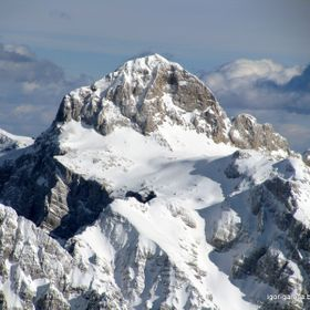 The picture is taken from the top of mountain Jalovec on february in winter time. The mountain on the picture is Triglav (2864 m). The highest mo...