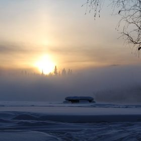 A misty fog rolling off the Chena River at sunset.