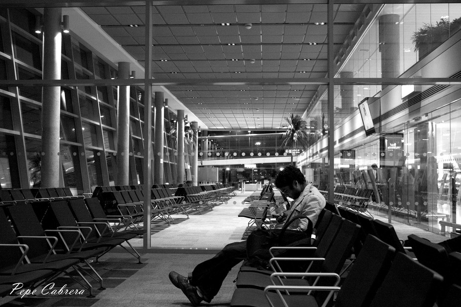A lone tourist waiting for his flight at an empty lounge in Abu Dhabi International Airport.