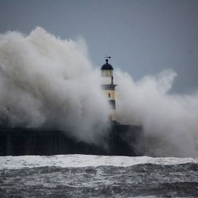 Seaham lighthouse and harbour being battered by the North Sea