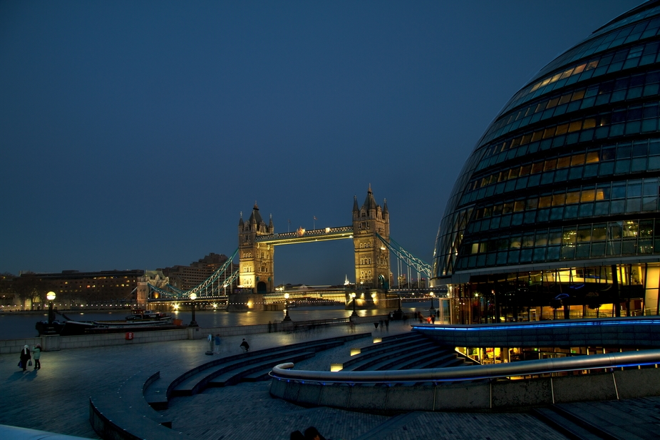 A picture of Tower Bridge and County Hall in London at night