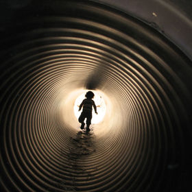 My granddaughter was running through a tunnel which was part of a maze made from giant bales of hay.