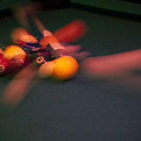 I'm really proud of this shot.  Dim bar (awesome - cheap booze and cheap pool) and I got the shot hand held and with no flash on full manual!