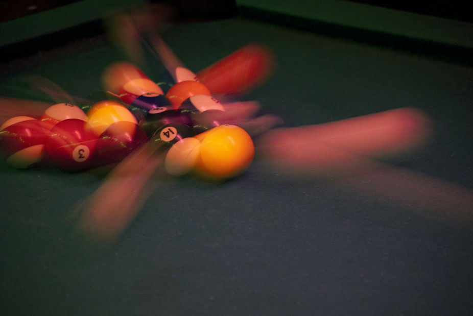 I\'m really proud of this shot.  Dim bar (awesome - cheap booze and cheap pool) and I got the shot...