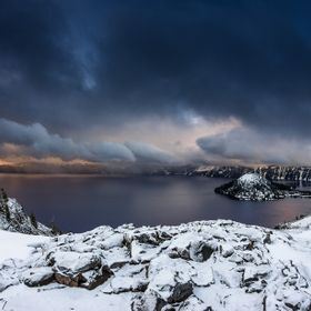 Immense storm cloud threatens Crater Lake after snow showers.