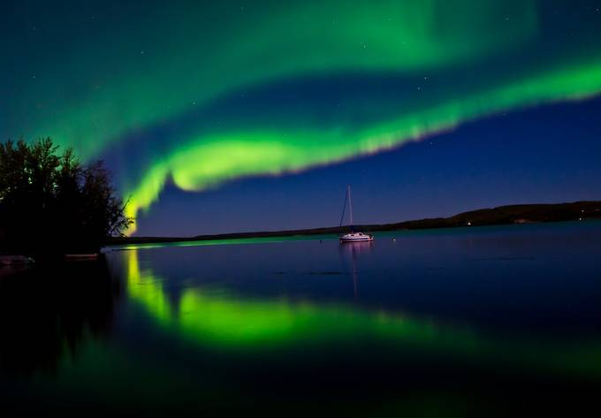 Auroras at the Lake by Peaceofthenorth - Light On Water Photo Contest