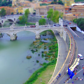View from the roof  top of the Castle , 'Castle  of San't Angelo' you will see here rolling store ,ambulance ,people,buses ,long river ' Tiber'  ...