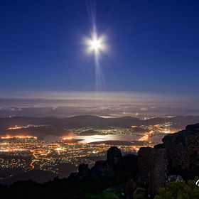 The full moon rising over the city of Hobart,Tasmania from near the summit of Mt. Wellington.