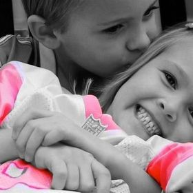 Black and white with selective coloring of brother and sister.