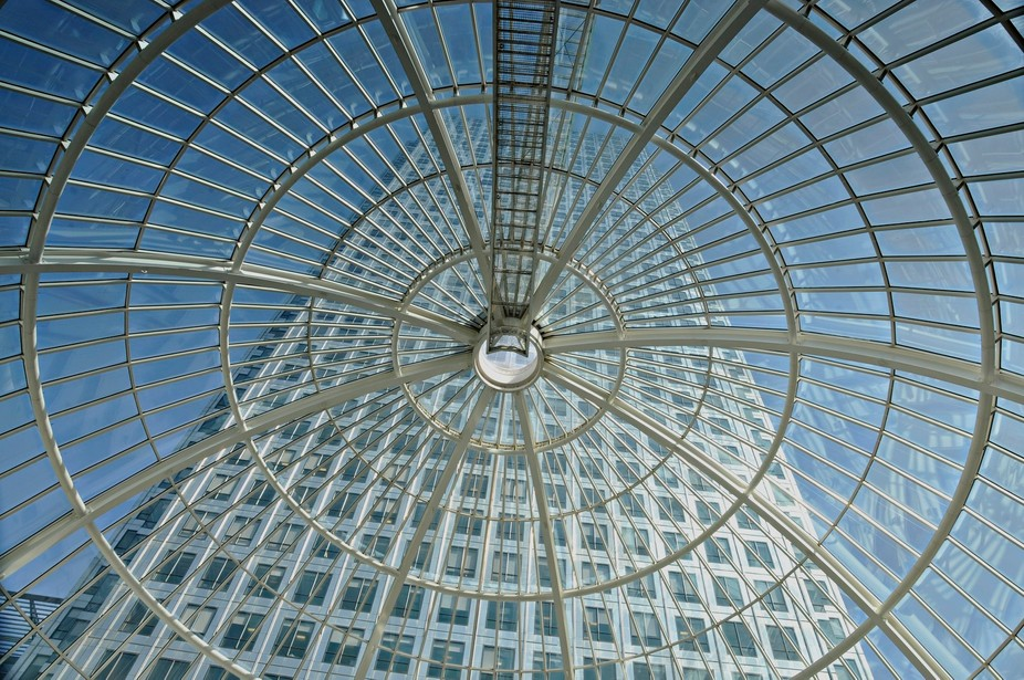 View through glass ceiling at Canary Wharf financial district, London