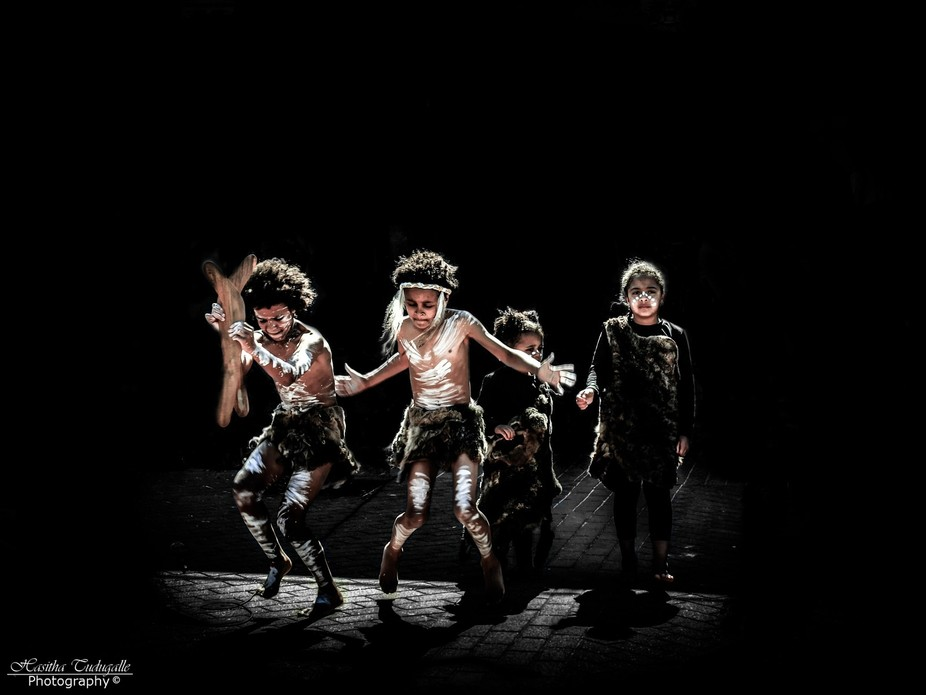 Australian Indigenous youths performing a traditional Aboriginal wind dance at the Festival of th...